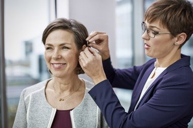 Woman being fitted for hearing aid